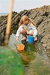 Teenage girl rock pooling Stock Photo - Premium Royalty-Freenull, Code: 649-07119900