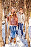 A portrait of two friends outside in the snow. Stock Photo - Premium Royalty-Freenull, Code: 6106-07120063