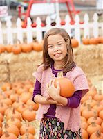 selecting - Kids at pumpkin patch Stock Photo - Premium Royalty-Freenull, Code: 6106-07120580