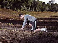 sprint - athlete in sprinting position Stock Photo - Premium Royalty-Freenull, Code: 6106-07121431