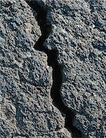 A Lava Field, With Black Solidified Rock Surface, With Fissures. Stock Photo - Premium Royalty-Freenull, Code: 6118-07122110