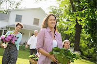 Family Party. Parents And Children Walking Across The Lawn Carrying Flowers, Fresh Picked Vegetables And Fruits. Preparing For A Party. Stock Photo - Premium Royalty-Freenull, Code: 6118-07122198