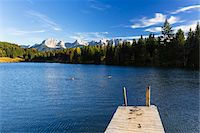 fall trees lake - Wooden Dock at Wagenbruchsee with Karwendel Mountains in Autumn, Bavaria, Germany Stock Photo - Premium Royalty-Freenull, Code: 600-07143693