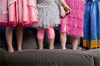 Children standing on sofa Stock Photo - Premium Royalty-Freenull, Code: 614-07145686