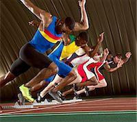 sprint - Five athletes starting a sprint race Stock Photo - Premium Royalty-Freenull, Code: 614-07145721