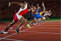 sprint - Athletes at start line of race Stock Photo - Premium Royalty-Freenull, Code: 614-07145730