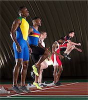 sprint - Athletes standing at start line of race Stock Photo - Premium Royalty-Freenull, Code: 614-07145734
