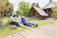 Couple relaxing on lawn Stock Photo - Premium Royalty-Freenull, Code: 614-07145951