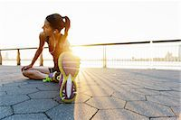 stretching (people exercising) - Young female jogger doing stretching exercise at sunrise Stock Photo - Premium Royalty-Freenull, Code: 614-07146061