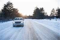 extreme terrain - Car driving along road in snow Stock Photo - Premium Royalty-Freenull, Code: 614-07146158