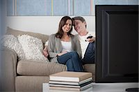 Mature couple watching tv Stock Photo - Premium Royalty-Freenull, Code: 614-07146242