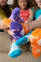 Girls wearing brightly coloured socks Stock Photo - Premium Royalty-Freenull, Code: 614-07146294