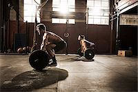 flexible (people or objects with physical bendability) - Two young adults working out with barbells in gym Stock Photo - Premium Royalty-Freenull, Code: 614-07146422