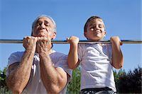 Man and grandson doing chin-ups Stock Photo - Premium Royalty-Freenull, Code: 614-07146500