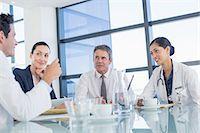 Doctors talking in meeting Stock Photo - Premium Royalty-Freenull, Code: 6113-07146706