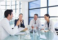 Doctors and business people talking in meeting Stock Photo - Premium Royalty-Freenull, Code: 6113-07146755