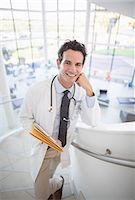 Portrait of smiling doctor on stairs in hospital Stock Photo - Premium Royalty-Freenull, Code: 6113-07146758