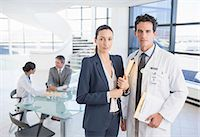 Portrait of confident doctor and businesswoman in meeting Stock Photo - Premium Royalty-Freenull, Code: 6113-07146792