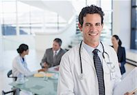 Portrait of smiling doctor in meeting Stock Photo - Premium Royalty-Freenull, Code: 6113-07146793