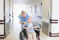 female doctor - Nurse with aging patient in wheelchair in hospital corridor Stock Photo - Premium Royalty-Freenull, Code: 6113-07146796