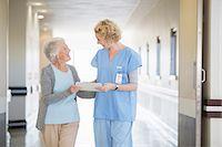 Nurse and senior patient talking in hospital corridor Stock Photo - Premium Royalty-Freenull, Code: 6113-07146808