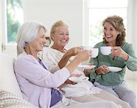 Senior women toasting coffee cups Stock Photo - Premium Royalty-Freenull, Code: 6113-07146879