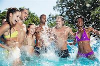 swimming pool water - Friends playing in swimming pool Stock Photo - Premium Royalty-Freenull, Code: 6113-07146985