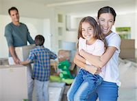 Mother and daughter hugging in new house Stock Photo - Premium Royalty-Freenull, Code: 6113-07147204