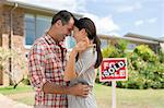 Couple hugging outside new house Stock Photo - Premium Royalty-Freenull, Code: 6113-07147214