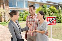 sold sign - Realtor giving couple keys to new house Stock Photo - Premium Royalty-Freenull, Code: 6113-07147217
