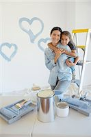 Mother and daughter hugging among paint supplies Stock Photo - Premium Royalty-Freenull, Code: 6113-07147218