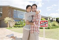 sold sign - Portrait of smiling couple hugging outside new house Stock Photo - Premium Royalty-Freenull, Code: 6113-07147233