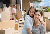 Mother and daughter smiling by moving van in driveway Stock Photo - Premium Royalty-Freenull, Code: 6113-07147250