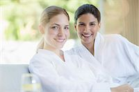 Portrait of smiling women in bathrobes at spa Stock Photo - Premium Royalty-Freenull, Code: 6113-07147350