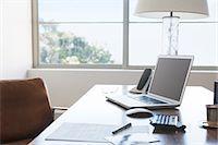 Laptop on desk in office Stock Photo - Premium Royalty-Freenull, Code: 6113-07147571