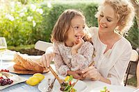 people eating at lunch - Mother and daughter eating in garden Stock Photo - Premium Royalty-Freenull, Code: 6113-07147647