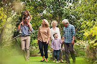 Multi-generation family walking together in park Stock Photo - Premium Royalty-Freenull, Code: 6113-07147660