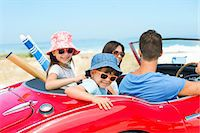 Family riding in convertible at beach Stock Photo - Premium Royalty-Freenull, Code: 6113-07147691