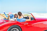 people and vacation - Family driving convertible to beach Stock Photo - Premium Royalty-Freenull, Code: 6113-07147706