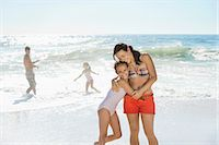 Mother and daughter hugging on beach Stock Photo - Premium Royalty-Freenull, Code: 6113-07147726