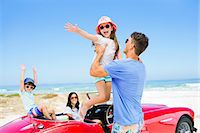 road trip - Father lifting daughter from convertible at beach Stock Photo - Premium Royalty-Freenull, Code: 6113-07147762