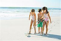 Children using metal detector on beach Stock Photo - Premium Royalty-Freenull, Code: 6113-07147791