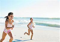 Girls running on beach Stock Photo - Premium Royalty-Freenull, Code: 6113-07147793