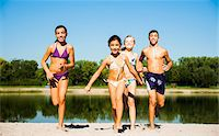 preteen swimsuit - Kids Running on Beach by Lake, Lampertheim, Hesse, Germany Stock Photo - Premium Royalty-Freenull, Code: 600-07148092