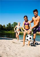 Kids Playing Soccer on Beach by Lake, Lampertheim, Hesse, Germany Stock Photo - Premium Royalty-Freenull, Code: 600-07148094