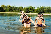 Kids Giving Piggy Back Rides in Lake, Lampertheim, Hesse, Germany Stock Photo - Premium Royalty-Freenull, Code: 600-07148099