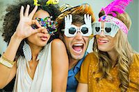 Smiling friends wearing decorative glasses Stock Photo - Premium Royalty-Freenull, Code: 6113-07148022
