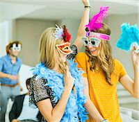 Women wearing decorative glasses and headpieces at party Stock Photo - Premium Royalty-Freenull, Code: 6113-07148028