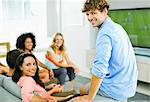Friends watching soccer game on sofa Stock Photo - Premium Royalty-Freenull, Code: 6113-07148038