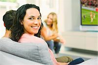 soccer fan - Portrait of smiling woman on sofa Stock Photo - Premium Royalty-Freenull, Code: 6113-07148044